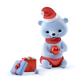 Christmas bear sitting with ball on hands, clipping path Stock Photo