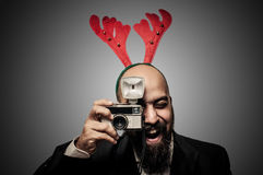 Christmas bearded man holding old camera Stock Images