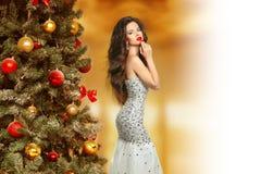 Christmas. Beautiful elegant brunette girl model in fashion dres Stock Photos