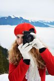 Christmas beautiful girl taking pictures Stock Photos