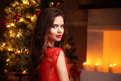 Christmas. Beautiful smiling woman. Makeup. Elegant lady in red Stock Images