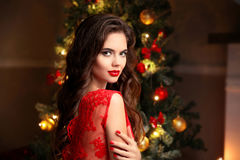 Christmas. Beautiful smiling woman. Manicure nails. Makeup. Heal Royalty Free Stock Photography