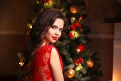 Christmas. Beautiful smiling woman portrait. Makeup. Healthy lon Stock Image