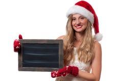 Christmas. Beautiful woman wear santa hat Stock Image