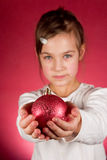 Christmas Beauty. Young girl with Christmas balls in hand Stock Photography