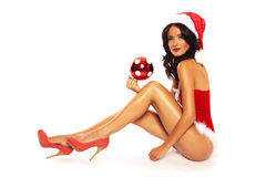 Christmas Beauty on white background - sexy long legs Royalty Free Stock Photos