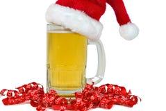 Santa hat on beer mug Royalty Free Stock Photography