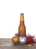 Christmas beer, baubles and tinsel. Still life. Royalty Free Stock Photo