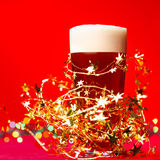 Christmas beer in tinsel Royalty Free Stock Photography