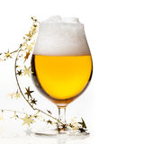 Christmas beer with tinsel Royalty Free Stock Images