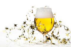 Christmas beer with tinsel Stock Image