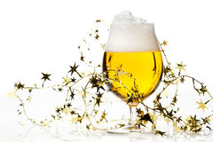 Christmas beer with tinsel Stock Photo