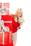 Christmas: From Behind Stack Of Gifts, Woman Holds Up Money Fan Stock Photos
