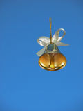 Christmas bell. On the blue sky Royalty Free Stock Image