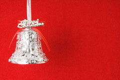 Christmas bell. In red background Stock Photo