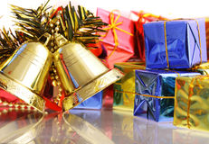 Christmas bell. And christmas gift Royalty Free Stock Photos