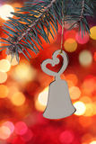 Christmas bell against blurred background Stock Image