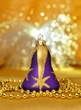 Christmas bell, beads around on light background Stock Image