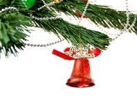 Christmas bell and  on the branch of a tree Stock Photos
