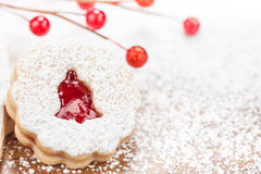 Christmas Bell Cookie. Christmas Linzer cookie decorated with powdered icing sugar and red Jam. Copy Space stock photography