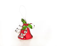 Christmas bell decoration. Red Christmas bauble decoration with holly isolated on white background Royalty Free Stock Image