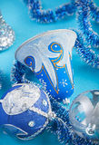 Christmas bell and decorations on blue Royalty Free Stock Photography