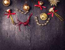 Christmas bell decorations on dark wooden background Stock Photo