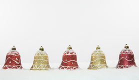 Christmas Bell Decorations in Snow Stock Photo