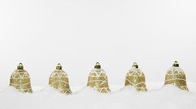 Christmas Bell Decorations and Snow Stock Image