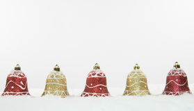 Christmas Bell Decorations and Snow Stock Photography