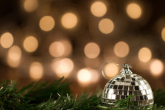 Christmas bell frosty is lying on a pine tree Royalty Free Stock Photography