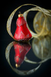 Christmas bell with gold ribbon Stock Photos