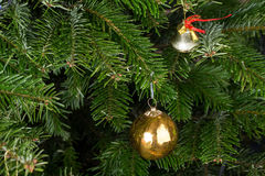 Christmas bell and golden ball. Royalty Free Stock Photo