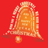 Christmas bell golden on red background Royalty Free Stock Images