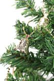 Christmas bell on green spruce branch Stock Photography