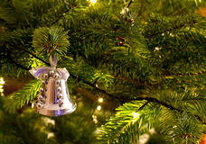 Christmas bell hanging on the christmas tree Royalty Free Stock Photography