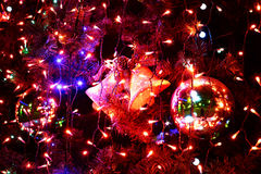 Christmas bell hanging on a christmas tree Royalty Free Stock Photography