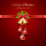 Christmas bell and holly berries on red background Stock Photography
