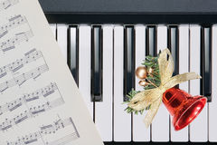 Christmas bell on keyboard. Piano stock images
