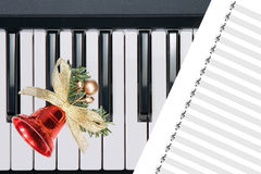 Christmas bell on keyboard Royalty Free Stock Photo