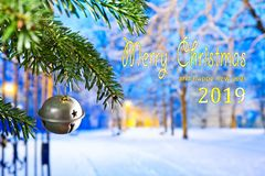 Text Merry Christmas 2019. Christmas Bell at night with text Merry Christmas 2019 stock photography
