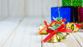 Christmas bell with a red bow and gift box Royalty Free Stock Photography