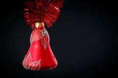 Christmas bell with red garland Stock Photography