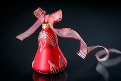 Christmas bell with red ribbon Royalty Free Stock Image