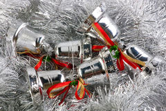 Christmas bell in silver garland Stock Images