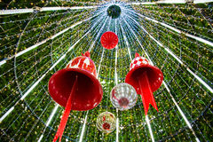 Christmas Bell and sparkles ball in a Christmas tree. Royalty Free Stock Photos