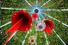Christmas Bell and sparkles ball in a Christmas tree. Royalty Free Stock Image