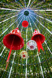 Christmas Bell and sparkles ball in a Christmas tree. Royalty Free Stock Photo
