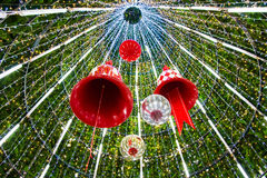 Christmas Bell and sparkles ball in a Christmas tree. Royalty Free Stock Images