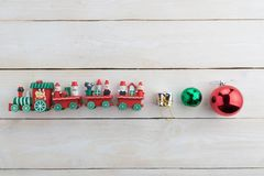 Christmas bell and toy train on wood. Background Royalty Free Stock Photos
